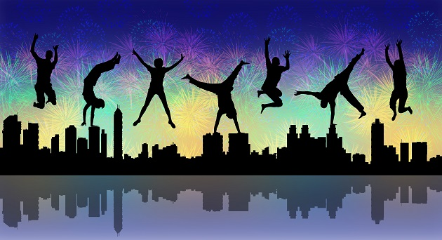 silhouettes of young happy people jumping a firework above a big city panoramic silhouette